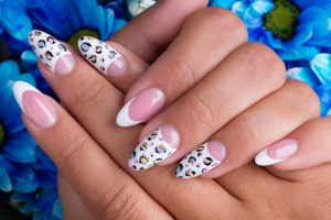beautiful-woman-s-nails-with-beautiful-french-manicure-and-art-design