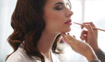 woman-having-her-make-up-done-by-make-up-artist